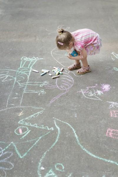 girl using sidewalk chalk