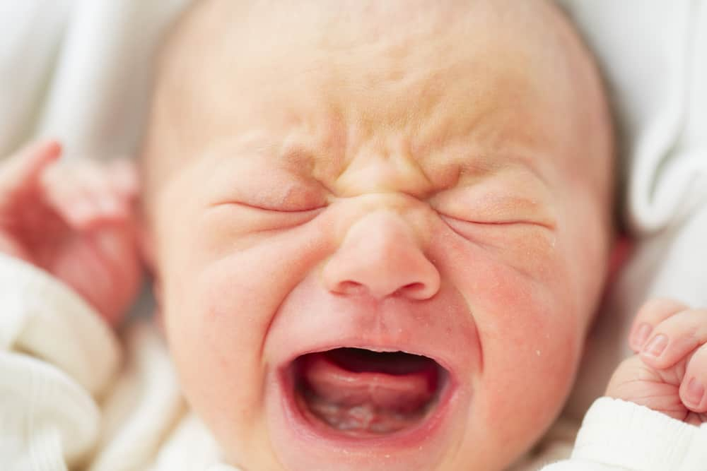 tired screaming infant