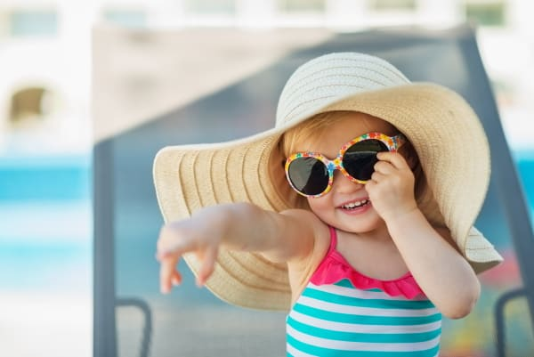 little girl in hat and sunglasses