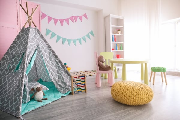kids play room with table, teepee and chair