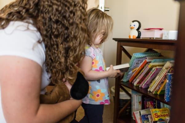 Nursery Bookshelf with girl choosing book