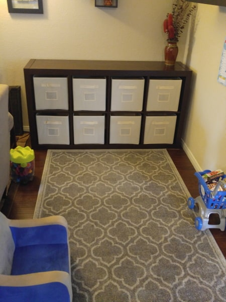 play area with rug and cube storage