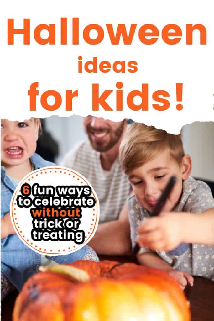 kids decorating Halloween pumpkin
