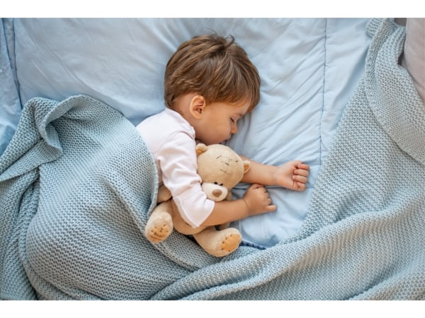 sleeping toddler with toy